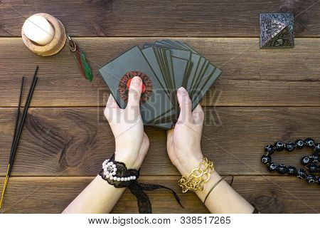 Minsk, Belarus, December 7.the Hands Of An Oracle With Cards Predict Fate. Draw Out A Card. Runic Ca