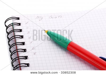 Goals list and pen isolated on white