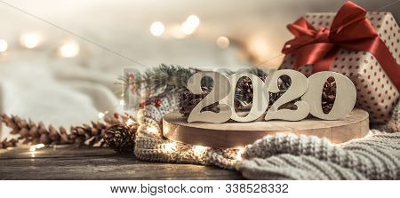 Background Festive New Year Background With 2020 Numbers On Wooden Background . With Lights And Deco