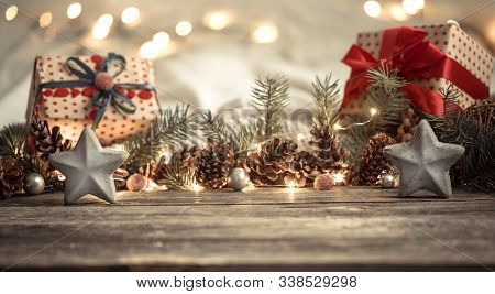 Composition With Christmas Decorations In The Interior. On A Wooden Background With Lights . The Con