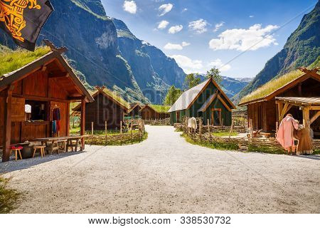 Gudvangen, Norway - June 13 - Traditional Wooden Houses And People In National Clothes In The Viking