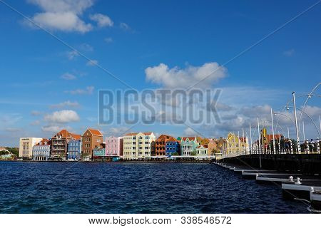 Curacao-11/3/19: The Queen Emma Floating Bridge And Pastel Colored Architecture Of Curacao Island.