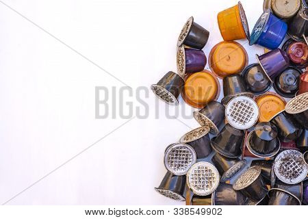 Used Coffee Capsules Of Various Colors And Flavors. These Capsules Are A Problem Because They Are Ex