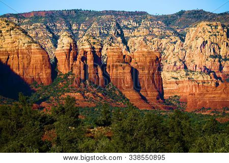 Red Rock Mesas Surrounded By A Coniferous Forest Taken In Sedona, Az Where People Connect With The S