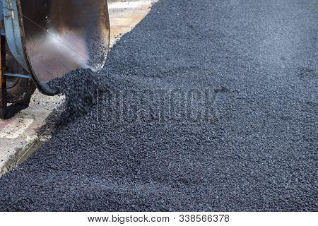 Blacktop Tarmac Street Repair Fresh Blacktop Poured From A Wheelbarrow.