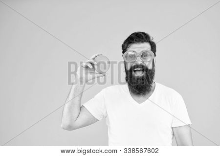 Orange Is High In Vitamin C. Hipster Holding Vitamin Fruit On Yellow Background. Bearded Man With He