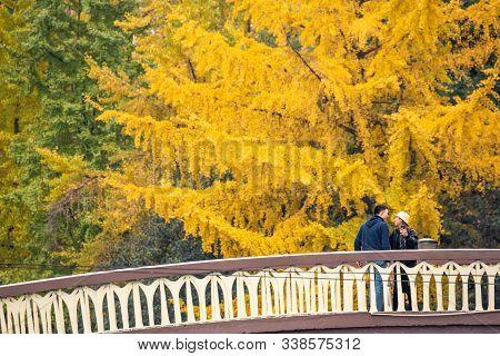 Chengdu, Sichuan Province, China - Dec 1, 2019 : Young Couple Standing On A Bridge By Jinjiang River