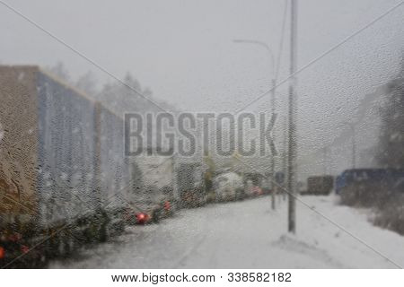 Cars On Winter Road Traffic Jam City. Winter Weather On The City Highway, The View From Police Car P