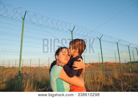 Release Of Prisoners On State Border Happy Child Kissing Mother After Family Reunion