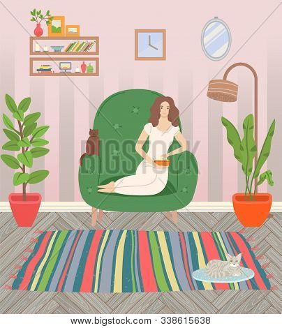 Girl Sitting In Armchair And Eating Popcorn. Cat On Rug, Fluffy Pets. Living Room Cosy Interior With