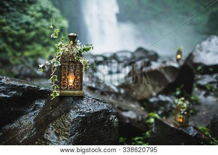 Old Vintage Copper Lantern With Burning Candles Inside As Wedding Decoration On Night Ceremony Outdo