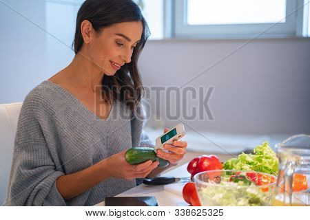 Smiling Lady With Cucumber And Nitrate Tester Stock Photo