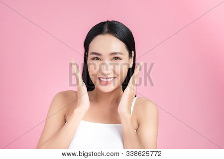Portrait Of Beautiful Asian Woman With Natural Make Up Touching Her Face. Natural Skin.