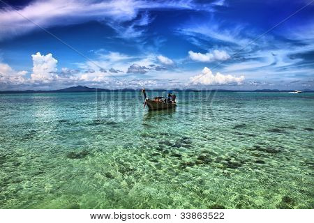 Seascape. A long tail boat in Thailand