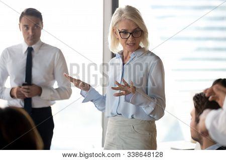 Mature Businesswoman, Business Coach Holding Briefing, Explaining Project
