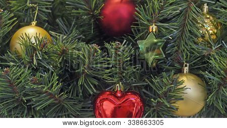 Christmas And New Year Hanging Decoration.multicoloured Christmas Balls And Star Toy On Tree Branche