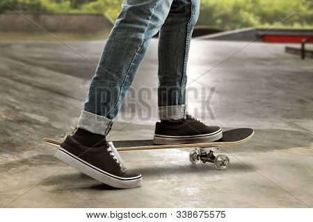 Skateboarder Skateboarding At Skate Park On Summer