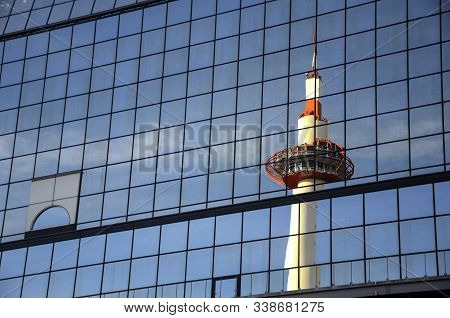 Kyoto, Japan- 24 Nov, 2019: Kyoto Tower Mirrored By Glass Steel Of Kyoto Railway Station Japan. The