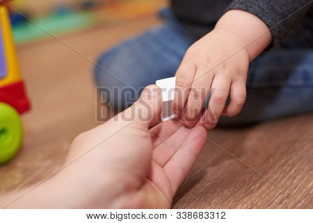 Dad Gives The Child A Figure For Folding Sorter Toys, Hands Close-up, Educational Games For Children