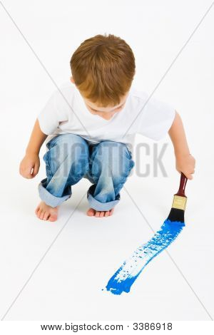 Child Painting A Blue Line