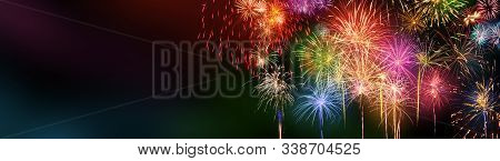Colorful Fireworks With Dark Copy Space On The Left, Panoramic Or Banner Format