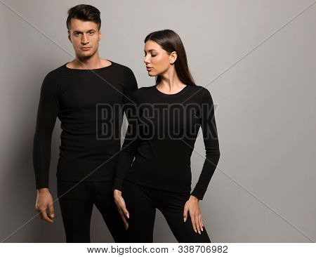 Couple Wearing Thermal Underwear On Grey Background. Space For Text