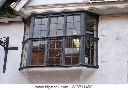 Old Bay Window With Leaded Glass And Black Painted Frame At Historic Building In Canterbury, England