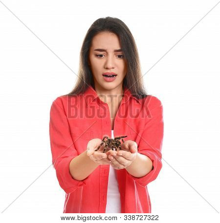 Scared Young Woman With Tarantula On White Background. Arachnophobia (fear Of Spiders)