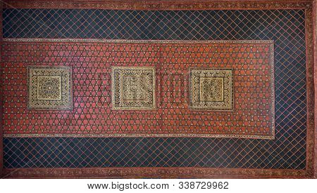 Cairo, Egypt- December 7 2019: Wooden Ceiling Decorated With Floral Patterns Painted In Red And Blue