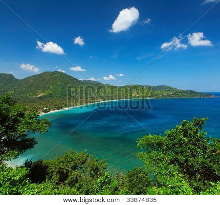 Tropical lagoon with clear water and trees on a coast. Lombok island