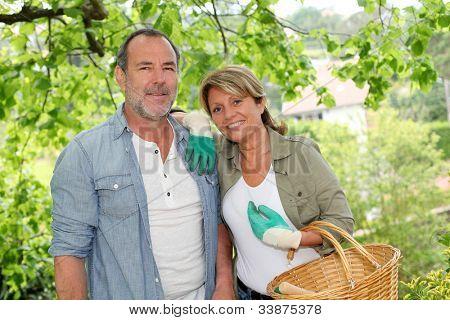 Happy senior couple gardening together