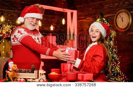 Cheerful Celebration. Festive Tradition. Child Enjoy Christmas With Bearded Grandfather Santa Claus.