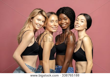 Multi Ethnic Group Of Womans With Diffrent Types Of Skin Standing Together And Looking On Camera. Di