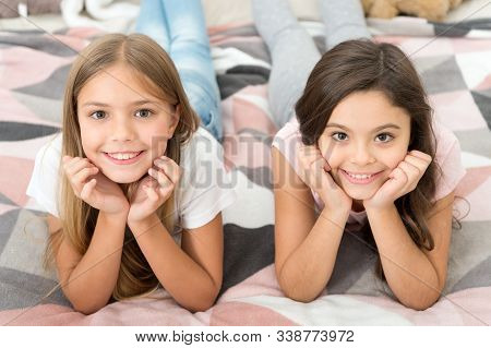 Free Your Smile. Little Girls Smile Relaxing On Bed. Happy Children Smiling. Dental Care. Dentistry