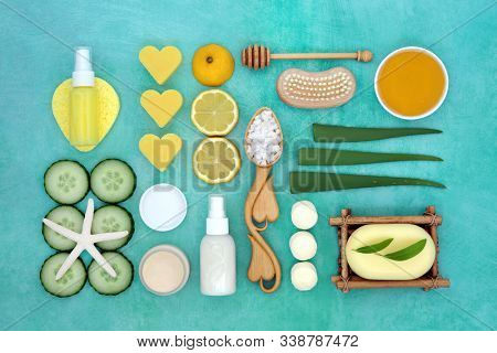 Natural vegan beauty & skin care treatment with aloe vera, cucumber & lemon fruit with spa, cleansing, moisturising and ex foliating products. Anti ageing health care concept. Flat lay, top view.