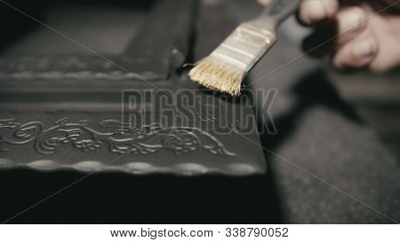 Forge Workshop. The Product Is Artificially Aged. Gold Powder Painting Of Scratches, Roughness And S