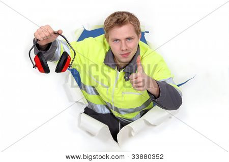 Worker giving the thumbs up to ear defenders