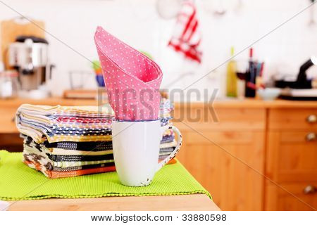 ?loth and a mug on the kitchen table