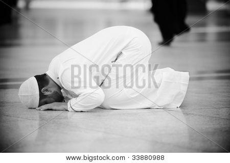 Muslim praying in Medina mosque outdoor poster