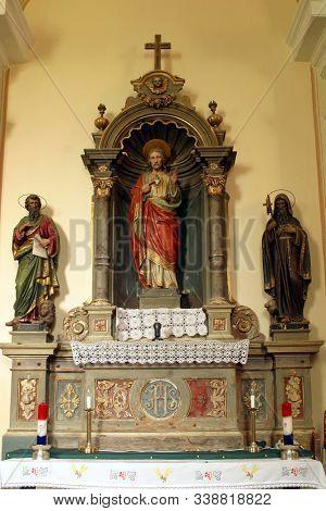 VELIKI BISAG, CROATIA - SEPTEMBER 20, 2011: Sacred Heart of Jesus altar in Saint Mary Magdalene Church in Veliki Bisag, Croatia