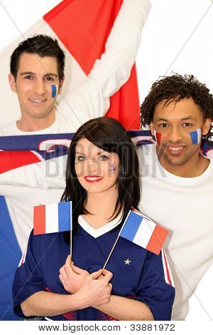 Three French people supporting their national team