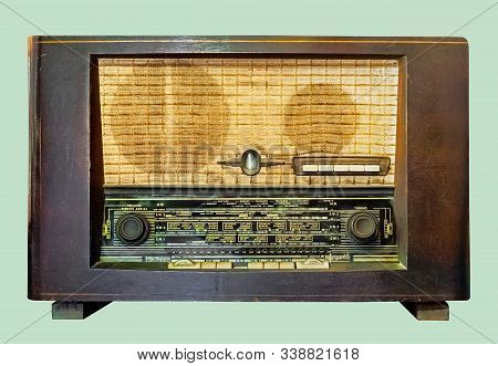 Old Tube Tabletop Radio In Wooden Case, On Isolated Pale Green Background With Clipping Path.
