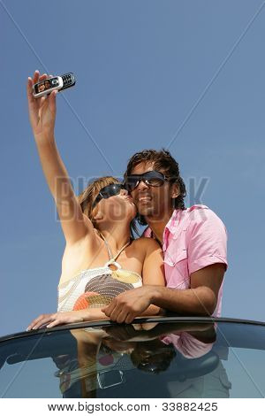 Couple taking a self-portrait with a cameraphone