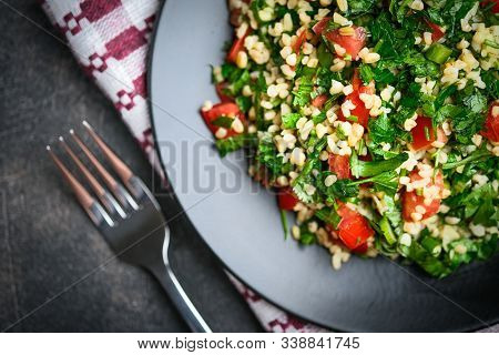 Traditional Oriental Salad Tabbouleh With Bulgur And Parsley On A Dark Background Top View Copy Spac