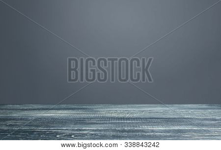 Empty gray background with wooden boards. Slide for presentations and placement of text, products and promotional items. Gray paper with white highlights. Beautiful and sophisticated, minimalism. poster