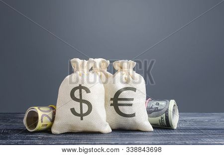 Money Bags And World Currencies. Capital Investment, Savings. Economics, Lending Business. Profit In