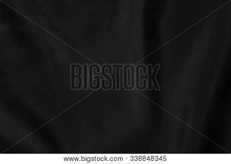 Black Colored Background Of Soft Draped Fabric