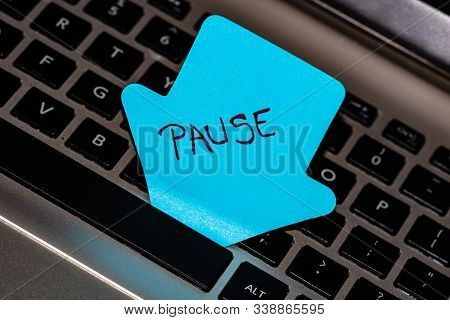 Writing On Colorful Sticky Note Pause. Text With Pause On Paper. Sticky Note, Post It On Keyboard.