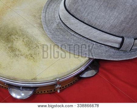Close-up Of A Samba Player (sambista) Hat And A Brazilian Percussion Musical Instrument: