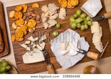 Cheese Board. Various Types Of Cheese. Cheese Plate With Cheeses Parmesan, Brie, Camembert And Roque